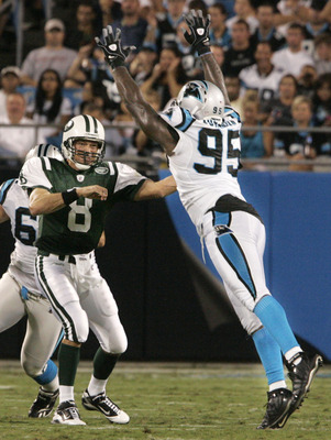 CHARLOTTE, NC - AUGUST 21:  Quarterback Mark Brunell #8 of the New York Jets throw under pressure from Charles Johnson #95 of the Carolina Panthers during their preseason game at Bank of America Stadium on August 21, 2010 in Charlotte, North Carolina. (Ph