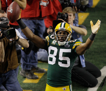 ARLINGTON, TX - FEBRUARY 06:  Greg Jennings #85 of the Green Bay Packers celebrates scoring a fourth quarter touchdown against the Pittsburgh Steelers  during Super Bowl XLV at Cowboys Stadium on February 6, 2011 in Arlington, Texas.  (Photo by Rob Carr/G