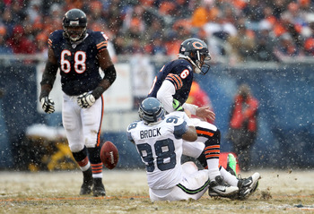 CHICAGO, IL - JANUARY 16:  Raheem Brock #98 of the Seattle Seahawks sacks quarterback Jay Cutler #6 of the Chicago Bears as Cutler fumbles the ball but the Bears recover in the second quarter in the 2011 NFC divisional playoff game at Soldier Field on Jan
