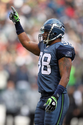 SEATTLE, WA - JANUARY 08:  Raheem Brock #98 of the Seattle Seahawks reacts after a defensive stop in the first half against the New Orleans Saints during the 2011 NFC wild-card playoff game at Qwest Field on January 8, 2011 in Seattle, Washington.  (Photo