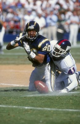 27 Sep 1998:  Wide Receiver Bryan Still #80 of the San Diego Chargers is tackled by Conrad Hamilton #41 of the New York Giants during a game at the Qualcomm Stadium in San Diego, California. The Giants defeated the Chargers 34-16.