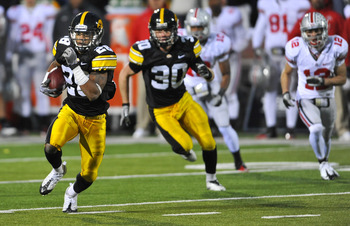 IOWA CITY, IA - NOVEMBER 20: Defensive back Shaun Prater #28 of the University of Iowa Hawkeyes returns a pass interception against the Ohio State Buckeyes during the second half of play at Kinnick Stadium on November 20, 2010 in Iowa City, Iowa. Ohio Sta