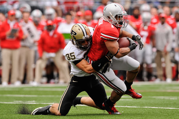 COLUMBUS, OH - OCTOBER 23:  Logan Link #35 of the Purdue Boilermakers tackles Dan Herron #1 of the Ohio State Buckeyes at Ohio Stadium on October 23, 2010 in Columbus, Ohio.  (Photo by Jamie Sabau/Getty Images)