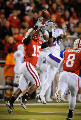 LINCOLN, NE - NOVEMBER 13: Alfonzo Dennard #15 of the Nebraska Cornhuskers takes the ball away from D.J. Beshears #20 of the Kansas Jayhawks during second half action of their game at Memorial Stadium on November 13, 2010 in Lincoln, Nebraska. Nebraska De