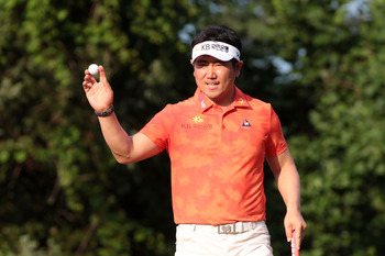 BETHESDA, MD - JUNE 17:  Y.E. Yang of South Korea waves to fans on the 16th green during the second round of the 111th U.S. Open at Congressional Country Club on June 17, 2011 in Bethesda, Maryland.  (Photo by Ross Kinnaird/Getty Images)