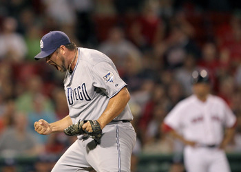 BOSTON, MA  - JUNE 21:  Heath Bell #21 of the San Diego Padres reacts in the ninth inning after a 5-4 win against the Boston Red Sox at Fenway Park on June 21, 2011 in Boston, Massachusetts.  (Photo by Jim Rogash/Getty Images)