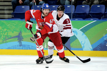 VANCOUVER, BC - FEBRUARY 23:  Jaromir Jagr #68 of Czech Republic is pursued by Janis Sprukts #5 of Latvia during the ice hockey Men's Play-off qualification match between the Czech Republic and Latvia on day 12 of the Vancouver 2010 Winter Olympics at UBC