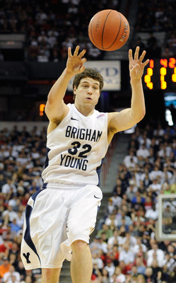 LAS VEGAS, NV - MARCH 12:  Jimmer Fredette #32 of the Brigham Young University Cougars passes the ball during the championship game of the Conoco Mountain West Conference Basketball tournament against the San Diego State Aztecs at the Thomas & Mack Center