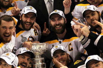 VANCOUVER, BC - JUNE 15:  Patrice Bergeron #37, Mark Recchi #28, Shawn Thornton #22, and Zdeno Chara #33 of the Boston Bruins pose with the Stanley Cup after defeating the Vancouver Canucks in Game Seven of the 2011 NHL Stanley Cup Final at Rogers Arena o