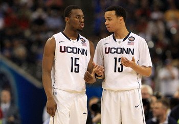 HOUSTON, TX - APRIL 02:  Kemba Walker #15 and Shabazz Napier #13 of the Connecticut Huskies talk on the court against the Kentucky Wildcats during the National Semifinal game of the 2011 NCAA Division I Men's Basketball Championship at Reliant Stadium on