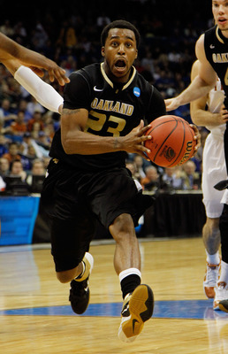 TULSA, OK - MARCH 18:  Reggie Hamilton #23 of the Oakland Golden Grizzlies drives with the ball against the Texas Longhorns during the second round of the 2011 NCAA men's basketball tournament at BOK Center on March 18, 2011 in Tulsa, Oklahoma.  (Photo by