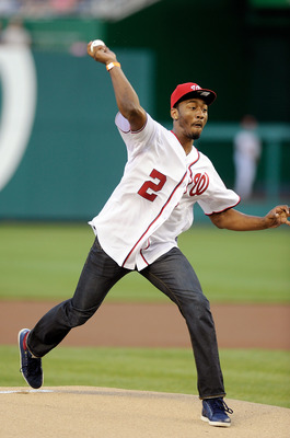 WASHINGTON, DC - JUNE 17:  Joh Wall of the Washington Wizards throws out the ceremonial first pitch before the game between the Baltimore Orioles and the Washington Nationals at Nationals Park on June 17, 2011 in Washington, DC.  (Photo by Greg Fiume/Gett