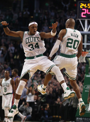 BOSTON, MA - JANUARY 19:  Ray Allen #20 of the Boston Celtics celebrates his game winning shot with teammate Paul Pierce #34 during the final seconds of the game against the Detroit Pistons on January 19, 2011 at the TD Garden in Boston, Massachusetts. Th