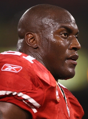 SAN FRANCISCO - DECEMBER 14:  Linebacker Takeo Spikes #51 of the San Francisco 49ers looks on before taking on the Arizona Cardinals at Candlestick Park on December 14, 2009 in San Francisco, California. (Photo by Jed Jacobsohn/Getty Images)