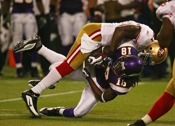 MINNEAPOLIS - SEPTEMBER 27: Takeo Spikes #51 of the San Francisco 49ers tackles Sidney Rice #18 of the Minnesota Vikings at the Hubert H. Humphrey Metrodome on September 27, 2009 in Minneapolis, Minnesota. The Vikings defeated the 49ers 27-24.  (Photo by