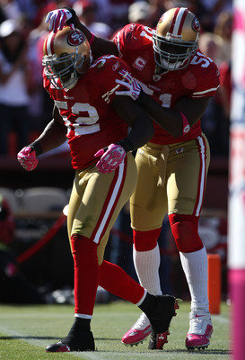 SAN FRANCISCO - OCTOBER 04:  Patrick Willis #52 of the San Francisco 49ers celebrates with Takeo Spikes #51 after returning an interception for a touchdown against the St. Louis Rams during an NFL game on October 4, 2009 at Candlestick Park in San Francis