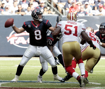 HOUSTON - OCTOBER 25:  Quarterback Matt Schaub #8 of the Houston Texans looks downfield for a receiver as linebacker Takeo Spikes #51 of the San Francisco 49ers applies pressure at Reliant Stadium on October 25, 2009 in Houston, Texas.  (Photo by Bob Leve