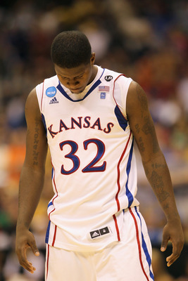 SAN ANTONIO, TX - MARCH 27:  Josh Selby #32 of the Kansas Jayhawks reacts after the southwest regional final of the 2011 NCAA men's basketball tournament against the Virginia Commonwealth Rams at the Alamodome on March 27, 2011 in San Antonio, Texas. Virg