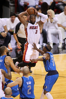 MIAMI, FL - JUNE 12:  Dwyane Wade #3 of the Miami Heat looks to pass the ball against the Dallas Mavericks in Game Six of the 2011 NBA Finals at American Airlines Arena on June 12, 2011 in Miami, Florida. NOTE TO USER: User expressly acknowledges and agre