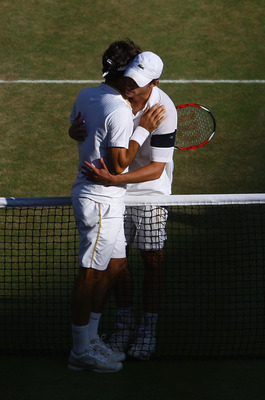 WIMBLEDON, ENGLAND - JULY 05:  A victorious Roger Federer of Switzerland embraces Andy Roddick of USA after the men's singles final match on Day Thirteen of the Wimbledon Lawn Tennis Championships at the All England Lawn Tennis and Croquet Club on July 5,