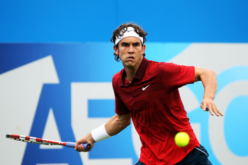 LONDON, ENGLAND - JUNE 06:  Ryan Sweeting of the United States eyes the ball during his Men's Singles first round match against Ivan Ljubicic of Croatia on day one of the AEGON Championships at Queens Club on June 6, 2011 in London, England.  (Photo by Ju
