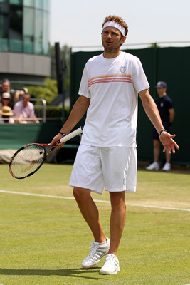 LONDON, ENGLAND - JUNE 23:  Mardy Fish of USA plays a shot during his second round match against Florian Mayer of Germany on Day Three of the Wimbledon Lawn Tennis Championships at the All England Lawn Tennis and Croquet Club on June 23, 2010 in London, E