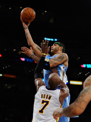 LOS ANGELES, CA - APRIL 03:  Kenyon Martin #4 of the Denver Nuggets scores a basket against Lamar Odom #7 of the Los Angeles Lakers during the second quarter of the NBS basketball game at Staples Center on April 3, 2011 in Los Angeles, California. NOTE TO