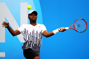LONDON, ENGLAND - JUNE 08:  Donald Young of the United States returns a shot during his Men's Singles second round match against Kevin Anderson of South Africa on day three of the AEGON Championships at Queens Club on June 8, 2011 in London, England.  (Ph