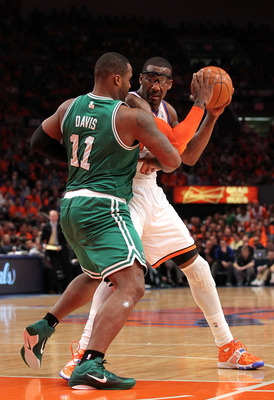 NEW YORK, NY - APRIL 24:  Amar'e Stoudemire #1 of the New York Knicks looks to pass against Glen Davis #11 of the Boston Celtics in Game Four of the Eastern Conference Quarterfinals during the 2011 NBA Playoffs on April 24, 2011 at Madison Square Garden i