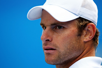 LONDON, ENGLAND - JUNE 10:  Andy Roddick of the United States takes a break during his Men's Singles quarter final match against Fernando Verdasco of Spain on day five of the AEGON Championships at Queens Club on June 10, 2011 in London, England.  (Photo