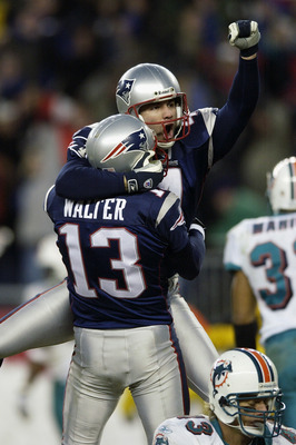 FOXBORO, MA - DECEMBER 29:  Adam Vinatieri #4 is lifted up by kick holder Ken Walter #13 of the New England Patriots after Vinatieri kicked a game-winning field goal in overtime to beat the Miami Dolphins at Gillette Stadium on December 29, 2002 in Foxbor