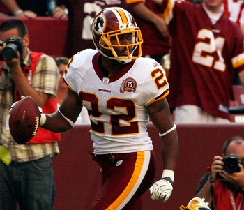 LANDOVER, MD - OCTOBER 07:    Washington Redskins cornerback Carlos Rogers #22 returns an interception for a touchdown in fourth quarter action against the Detroit Lions at FedEx Field October 7, 2007 in Landover, Maryland. The Redskins defeated the Lions
