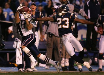 SAN DIEGO - JANUARY 14:  Wide receiver Reche Caldwell #87 of the New England Patriots catches a 49 yard reception past Quentin Jammer #23 of the San Diego Chargers during the AFC Divisional Playoff Game held at Qualcomm Stadium January 14, 2007 in San Die