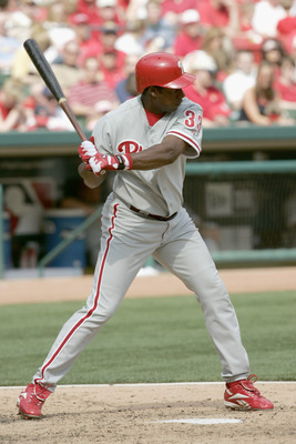 ST. LOUIS, MO - APRIL 10:  Outfielder Jose Offerman #33 of the Philadelphia Phillies swings at a St. Louis Cardinals pitch during the game at Busch Stadium on April 10, 2005 in St. Louis, Missouri. The Phillies defeated the Cards 13-4. (Photo by Dilip Vis