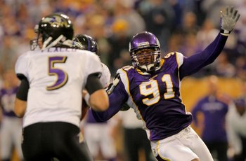 MINNEAPOLIS - OCTOBER 18:  Defensive end Ray Edwards #91 of the Minnesota Vikings rushes quarterback Joe Flacco #5 of the Baltimore Raven during NFL action at Hubert H. Humphrey Metrodome on October 18, 2009 in Minneapolis, Minnesota. The Vikings defeated