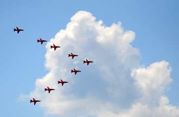 LONDON, ENGLAND - JUNE 11:  The Red Arrows perform a fly-past over the AEGON Championships at Queens Club after the Trooping the Colour parade on June 11, 2011 in London, England.  The ceremony of Trooping the Colour is believed to have first been perform