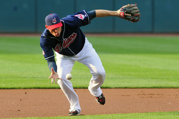 CLEVELAND, OH - JUNE 7: Asdrubal Cabrera #13 of the Cleveland Indians bare hands a ground ball during the first inning against the Minnesota Twins at Progressive Field on June 7, 2011 in Cleveland, Ohio. (Photo by Jason Miller/Getty Images)