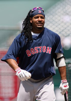 ANAHEIM, CA - JULY 20:  Manny Ramirez #24 of the Boston Red Sox walks with a bat and ball during practice before the game against the Los Angeles Angels of Anaheim at Angels Stadium on July 20, 2008 in Anaheim, California.  (Photo by Christian Petersen/Ge