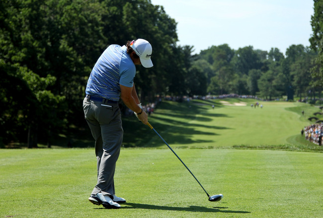 BETHESDA, MD - JUNE 17: Rory McIlroy of Northern Ireland hits his tee shot on the 11th hole  during the second round of the 111th U.S. Open at Congressional Country Club on June 17, 2011 in Bethesda, Maryland.  (Photo by Andrew Redington/Getty Images)