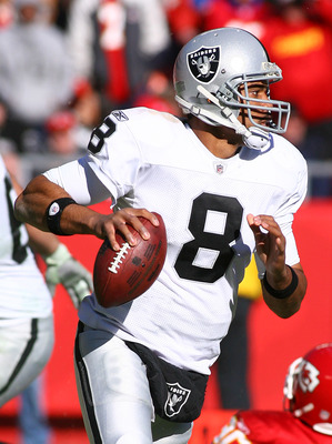 KANSAS CITY, MO - JANUARY 02:  Quarterback Jason Campbell #8 of the Oakland Raiders drops back to pass in a game against the Kansas City Chiefs at Arrowhead Stadium on January 2, 2011 in Kansas City, Missouri.  (Photo by Tim Umphrey/Getty Images)