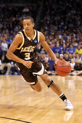OKLAHOMA CITY - MARCH 18:  CJ McCollum #3 of the Lehigh Mountain Hawks drives against the Kansas Jayhawks during the first round of the 2010 NCAA men's basketball tournament at Ford Center on March 18, 2010 in Oklahoma City, Oklahoma.  (Photo by Ronald Ma