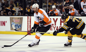 BOSTON, MA - MAY 04:  Jeff Carter #17 of the Philadelphia Flyers tries to keep the puck from Michael Ryder #73 of the Boston Bruins in Game Three of the Eastern Conference Semifinals during the 2011 NHL Stanley Cup Playoffs at TD Garden on May 4 , 2011 in