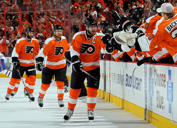 PHILADELPHIA - MAY 24:  Mike Richards #18 of the Philadelphia Flyers celebrates with his team after scoring a goal in the first period against Jaroslav Halak #41 of the Montreal Canadiens in Game 5 of the Eastern Conference Finals during the 2010 NHL Stan