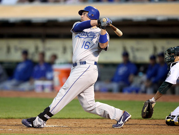 OAKLAND, CA - JUNE 14:  Billy Butler #16 of the Kansas City Royals hits a two run double in the fourth inning against the Oakland Athletics at Oakland-Alameda County Coliseum on June 14, 2011 in Oakland, California.  (Photo by Jed Jacobsohn/Getty Images)