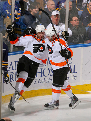 BUFFALO, NY - APRIL 18:  Jeff Carter #17 and Mike Richards #18 of  the Philadelphia Flyers celebrate after Carter scored Philadelphia's first goal against the Buffalo Sabres in Game Three of the Eastern Conference Quarterfinals during the 2011 NHL Stanley