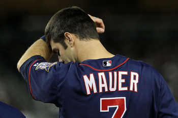 NEW YORK - OCTOBER 09:  Joe Mauer #7 of the Minnesota Twins wipes his forehead against the New York Yankees during Game Three of the ALDS part of the 2010 MLB Playoffs at Yankee Stadium on October 9, 2010 in the Bronx borough of New York City.  (Photo by