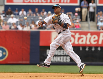 NEW YORK, NY - JUNE 16:  Robinson Cano #24 of the New York Yankees in action against the Texas Rangers during their game on June 16, 2011 at Yankee Stadium in the Bronx borough of New York City.  (Photo by Al Bello/Getty Images)