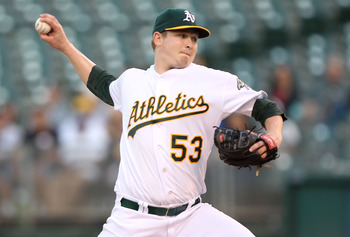 OAKLAND, CA - JUNE 14:  Starting pitcher Trevor Cahill #53 of the Oakland Athletics pitches against the Kansas City Royals at the Oakland-Alameda County Coliseum on June 14, 2011 in Oakland, California.  (Photo by Jed Jacobsohn/Getty Images)