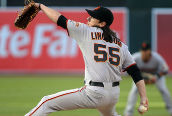 OAKLAND, CA -  JUNE 17: Tim Lincecum #55 of the San Francisco Giants pitches in the bottom of the first inning against the Oakland Athletics during a MLB baseball game June 17, 2011 at the Oakland-Alameda County Coliseum in Oakland, California. (Photo by