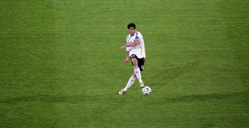 DORTMUND, GERMANY - JUNE 14:  Michael Ballack of Germany makes a pass during the FIFA World Cup Germany 2006 Group A match between Germany and Poland at the Stadium Dortmund on June 14, 2006 in Dortmund, Germany.  (Photo by Laurence Griffiths/Getty Images